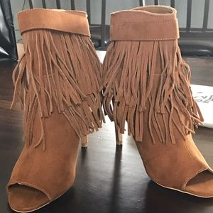 Fringed, open toe boots